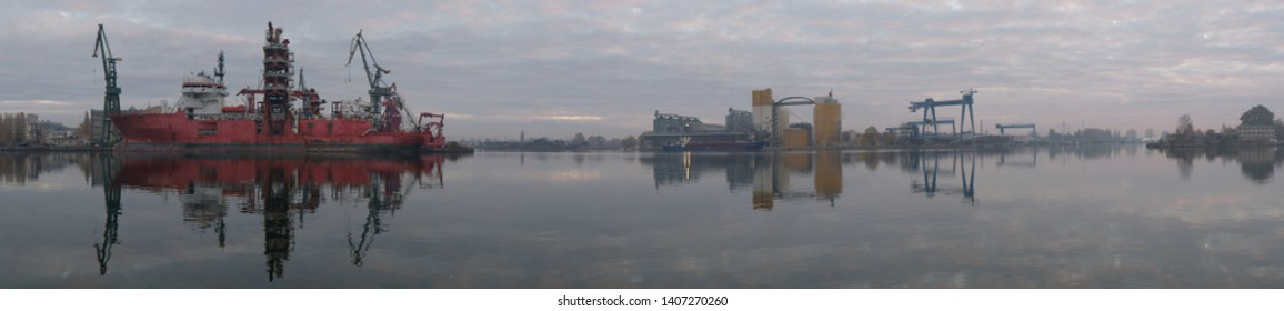 Panorama of Gdansk shipyard area - cranes and ships. The Imperial Shipyard Trail, Gdansk Shipyard, Poland