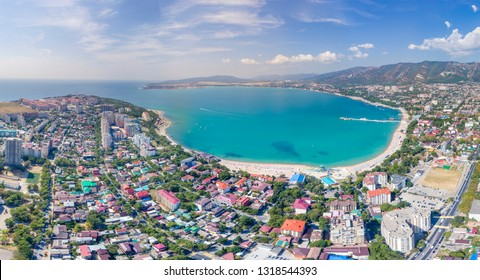 panorama of Gelendzhik from a bird's eye view. Gelendzhik Bay, Caucasus mountains, lighthouse, embankment, houses, streets. The resorts of Krasnodar region