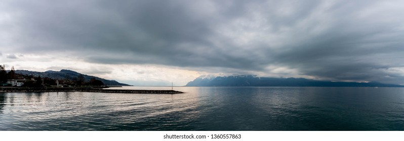 panorama of Geneva lake and mountain with clouds, storm, Geneva lake, Pully port, Switzerland