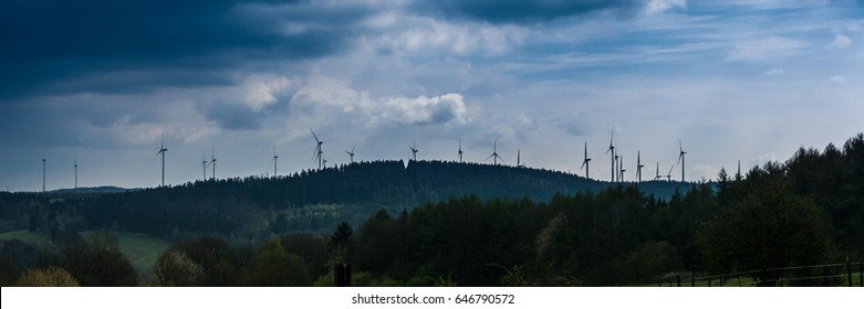 panorama of German lanscape of which the skyline is dominated by environmental friendly windmills