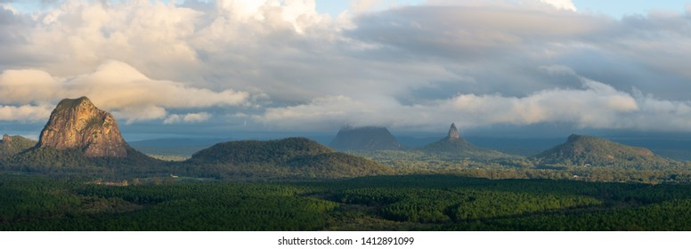 Panorama of the Glasshouse Mountains in the early morning sun. Queensland, Australia.