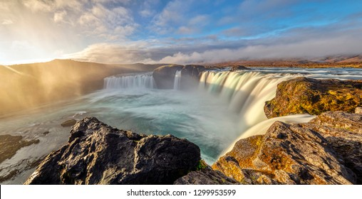 Panorama of Godafoss Waterfall at Sunrise. Godafoss is located in Northeast Iceland.