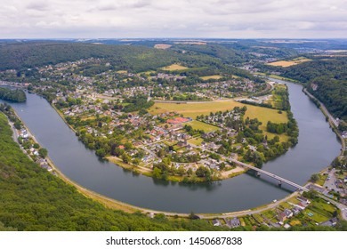 Panorama of Godinne in Ardennes. a small town on river Meuse in Ardennes region between Dinant and Namur. Scenic countyside with meander of river Meuse and small town. Godinne, Ardennes, Belgium.