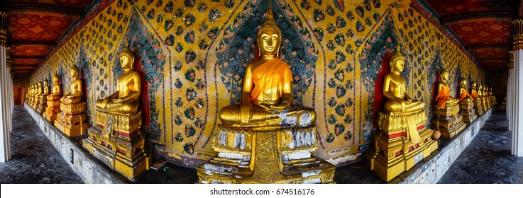 Panorama of Golden buddha image at corridor in Wat Arun Ratchawararam Ratchawaramahawihan or Temple of Dawn in bangkok thailand. This is beautiful row of golden buddha image in the temple of thailand.