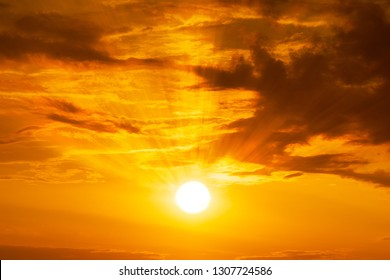 Panorama of Golden hour orange sky with clouds and the yellow sun shining nature background sunrise or sunset scene