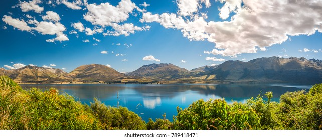 Panorama at Golden Hour at Wakatipu Lake close to Queenstown, in the Southern island of New Zealand.
