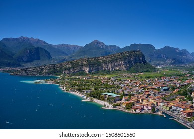 Panorama of the gorgeous Lake Garda surrounded by mountains in Riva del Garda, Italy