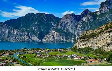 Panorama of the gorgeous Lake Garda surrounded by mountains in Riva del Garda, Italy. Lake Garda Italy