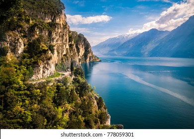 Panorama of the gorgeous Lake Garda surrounded by mountains in Riva del Garda, Italy.