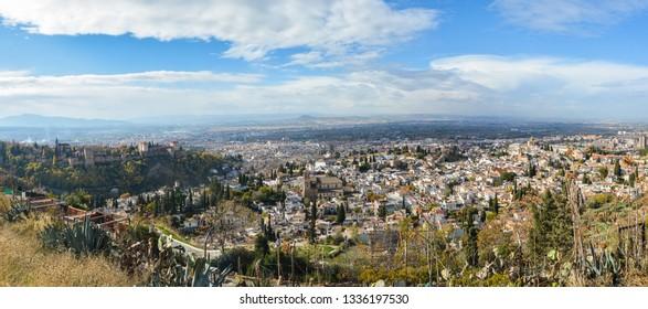 Panorama of Granada from the hill. Summer urban landscape in Andalusia.