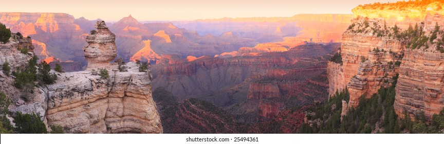 Panorama of the Grand Canyon (South Rim) with Sunset Colors Reflecting in the Rocks.