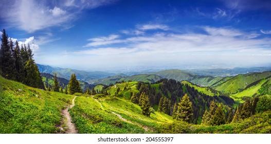 Panorama of green hills in Zaili Alatau mountains, Almaty, Kazakhstan