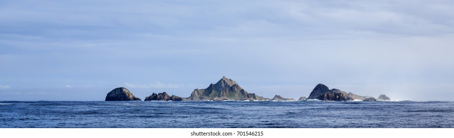 Panorama of group of  Farallon Islands sea stacks  off coast of San Francisco in the Gulf of Farallon on a sunny, clear day