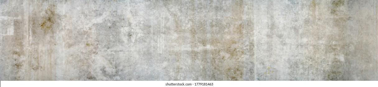 Panorama of a grungy concrete wall as background or texture