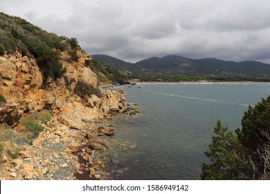 Panorama of the Gulf of Lacona, Elba Island, Tuscany Italy, with rocks, bay and cloudy sky