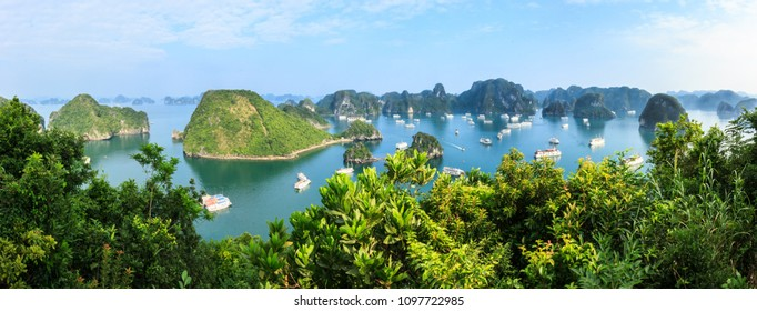 Panorama of Ha Long Bay islands, tourists enjoy boat cruise and seascape, Ha Long, Vietnam, Asia. UNESCO world heritage site, popular landmark and landscape, famous destination in Halong, Vietnam.