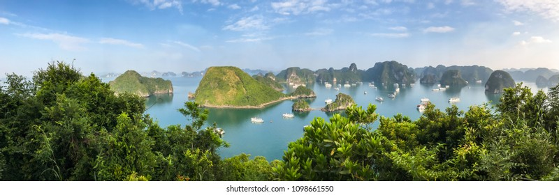 Panorama of Ha Long Bay islands, tourist boat and seascape, Ha Long, Vietnam.