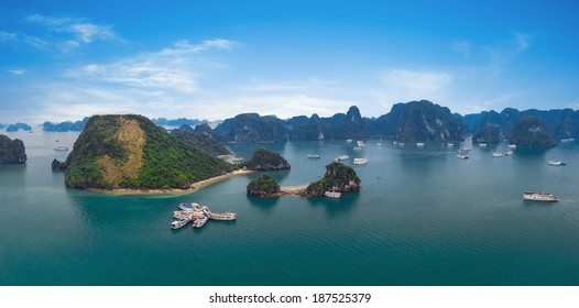 Panorama of Halong Bay Vietnam. Panoramic view of Ha Long islands, tourist junks, rock mountains and tropical sea water of famous landmark in Asia