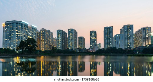 Panorama of Hanoi city cityscape at sunset with reflection of apartment buildings skyline in 2020