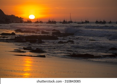 Panorama of the harbor of Manora during a wonderful orange sunset. Peru 2015
