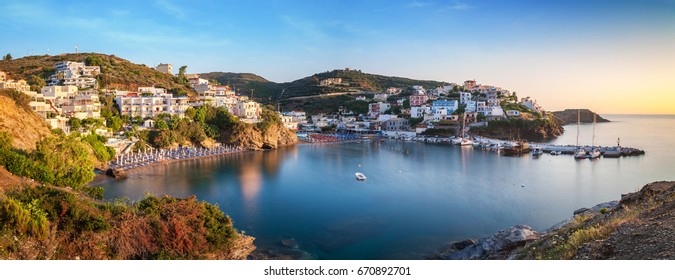 Panorama of Harbour with vessels, boats, beach and lighthouse in Bali at sunrise, Crete, Greece