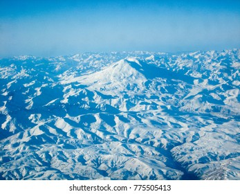 Panorama from height of flight of the aircraft in the valley of mount Elbrus and mount Elbrus in the North Caucasus of Russia in the winter