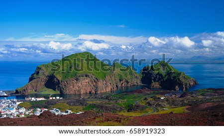 Panorama of Heimaey island and city at Vestmannaeyjar archipelago, Iceland