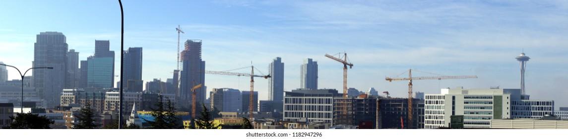 Panorama,  high rise construction cranes  across downtown  Seattle, Washington