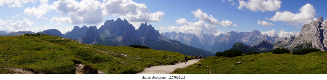 Panorama of hikers and pinnacles of the Dolomites Alps, Italy
