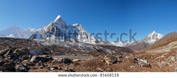 Panorama of the himalayan peaks Ama Dablam and Taboche - Nepal