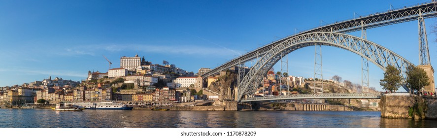 Panorama of the historic city of Porto with famous bridge Ponte dom Luis and boats on Douro river, Portugal