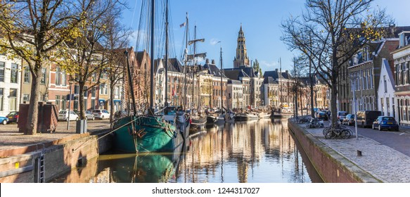 Panorama of historic ships and warehouses in the center of Groningen, Netherlands