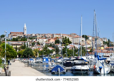 Panorama of the historical Vrsar town on the Istria peninsula, Croatia, with its Adriatic sea marina full of fishing bats and luxury yachts