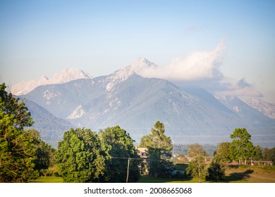 Panorama of the Hochstuhl mount, also called Veliki Stol vrh, between Slovenia and Austria, during a sunset, summit above clouds. It is a major mountain of the Julian Alps, in the karawanks chain.