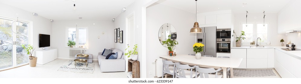 panorama of a home with kitchen and living room