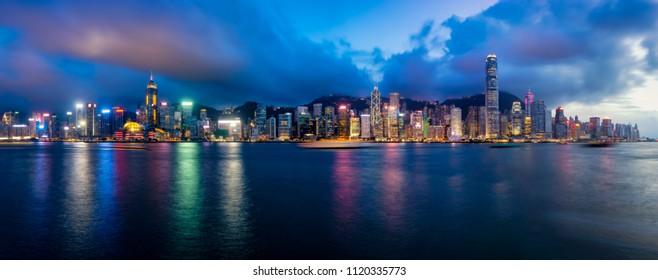 Panorama of Hong Kong City skyline at night. View from across Victoria Harbor Hongkong.