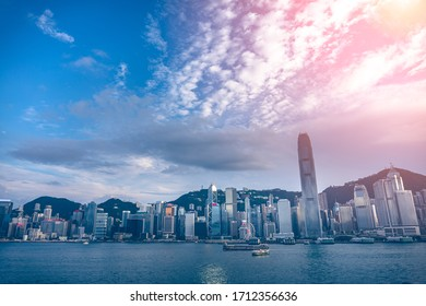Panorama of Hong Kong City skyline from across Victoria Harbor; with Sunlight effect