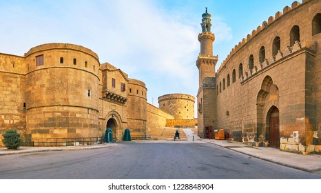 Panorama with huge stone gate of Military Museum, old circle watchtower and the Mosque of Al-Nasir Muhammad with carved minaret, Cairo, Egypt.
