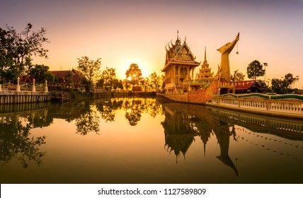 Panorama A huge Thai Suphannahong, also called Golden Swan or Phoenix boat at the WatpahSuphannahong Temple twilight time in sisaket, Thailand.Warm tone concept.