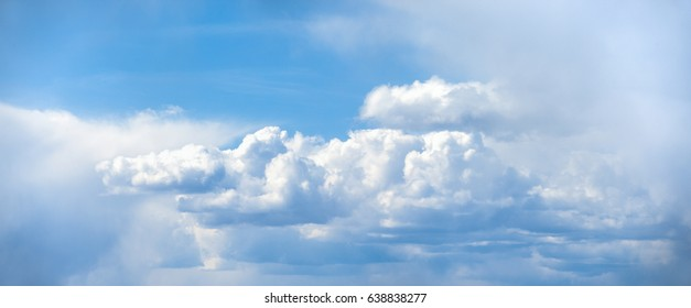 Panorama of a huge white cloud against a blue sky. Roof of the world.