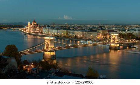 Panorama of the Hungarian Parliament, and the Chain bridge (Szechenyi Lanchid), over the River Danube, Budapest, Hungary, at night