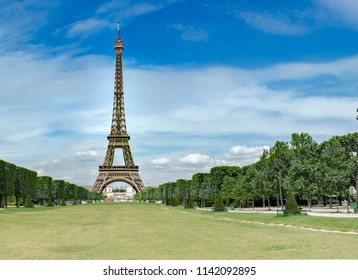 Panorama of iconic Eiffel Tower (1889) symbol of Paris and Champ-De-Mars park