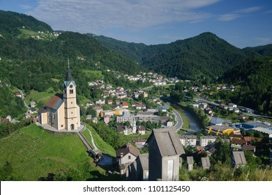 Panorama of the Idrija town with sv. Anton church and Idrija river, Slovenia
