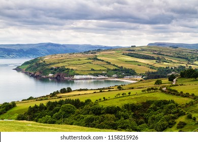 Panorama of an idyllic, peaceful and calm Irish landscape. View of town and village on the rolling hills during warm summer days.