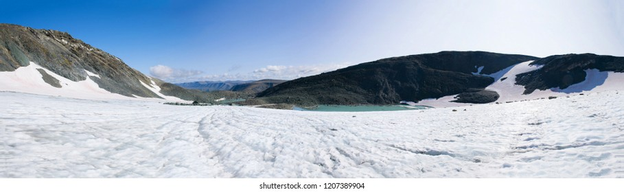 Panorama of the IGAN glacier on a sunny day. Polar Ural, Russia