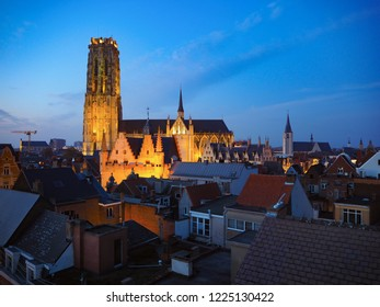 Panorama of the illuminated city center of Mechelen and the St. Rumbol's Cathedral, shortly after sunset. Belgium