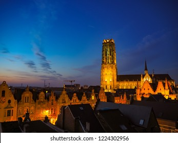 Panorama of the illuminated medieval town of Mechelen and the St. Rumbold's Cathedral in the early evening, Belgium