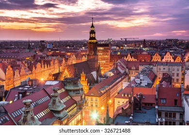 Panorama illuminated old town part of Wroclaw at night. Popular outsourcing service city. High dynamic range.