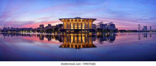 Panorama image of Masjid Sultan Mizan Zainal Abidin or Iron Mosque in Putrajaya, Malaysia during sunrise.