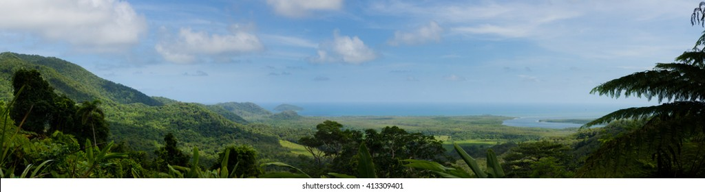 Panorama image of the vast Australian rain forest and the pacific ocean